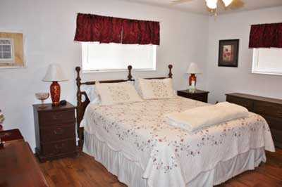 The stately master bedroom features a soft and comfortable king-sized bed, and all bed and bath linens are provided for your stay.