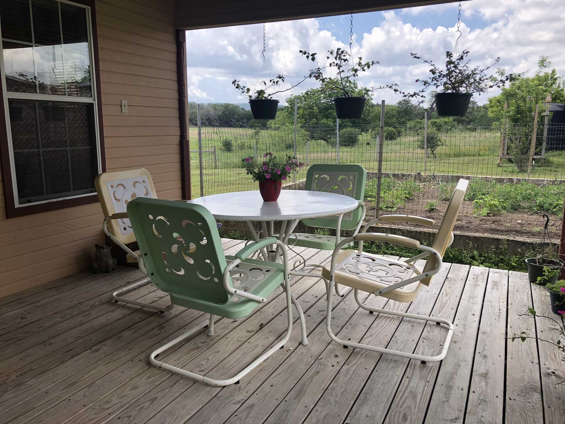 The shaded porch is perfect for so many things: sipping your morning coffee, planning your day, not to mention laughter and conversation.