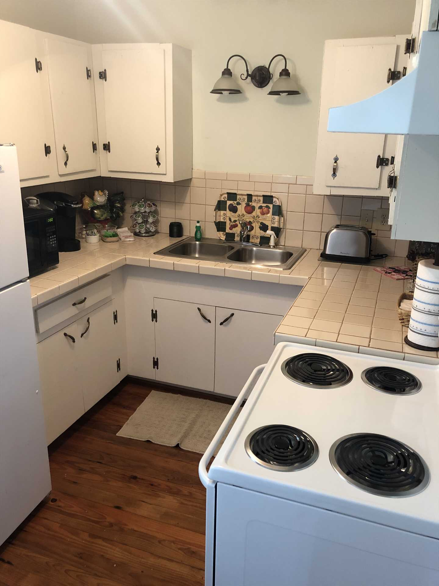Appliances, cooking ware, and serving ware are provided in the full kitchen. You'll also be pampered with complimentary breakfast and home-baked cookies!