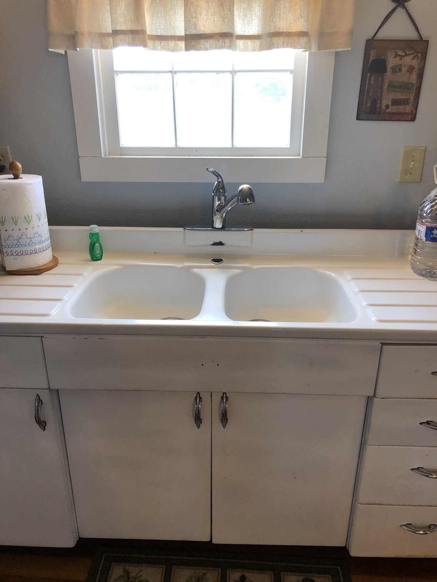 Youngstown kitchen cabinets, and the accompanying twin sink, are vintage furnishings as historic as the house itself!