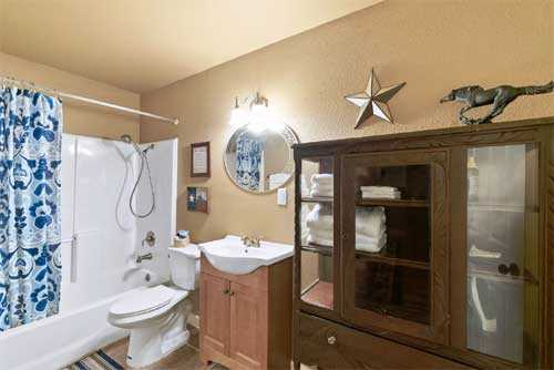 Genuine Texas touches can even be found in the full bath, as well as a shower and tub combo.
