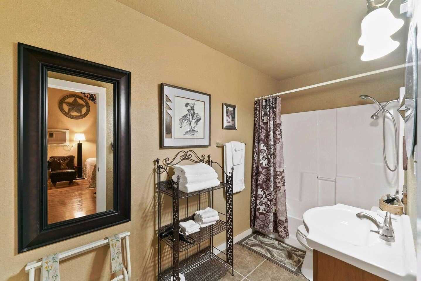 The full bath is furnished with a shower and tub combo and big vanity-and all bed and bath linens are included.