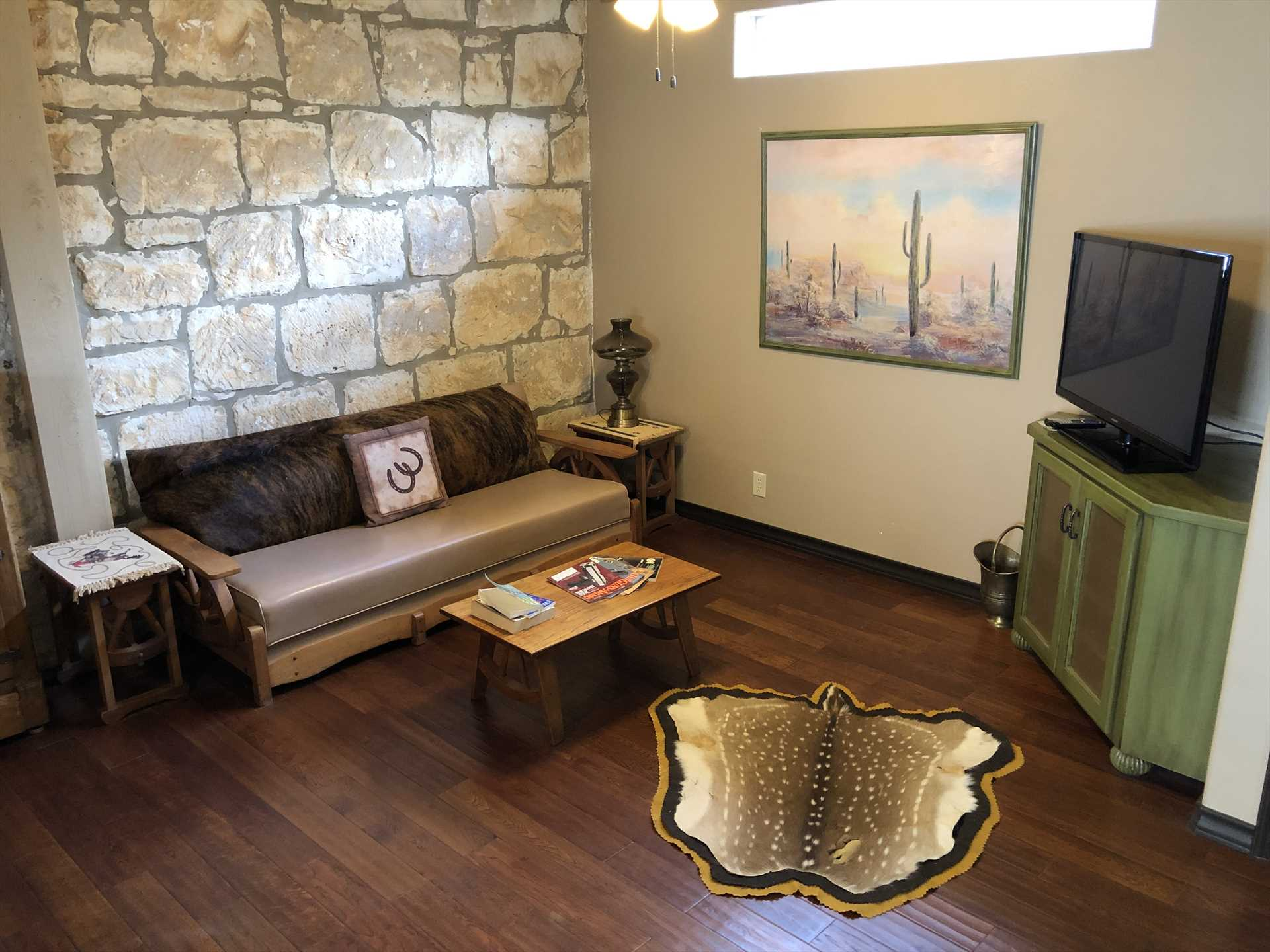 The living area evokes the history of the American cowboy, right at home in the Cowboy Capital of the World!