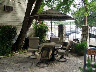 Comfy swivel chairs surround the table on the shaded outdoor patio!