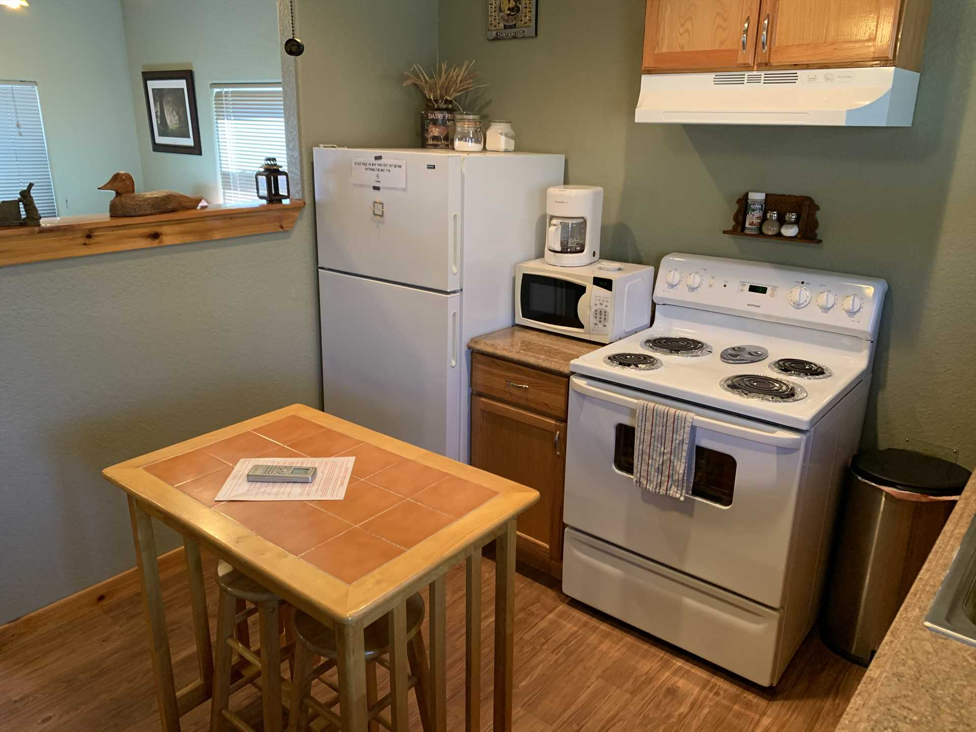 Pots, pans, utensils, dishes and glasses are provided in the kitchen, too.