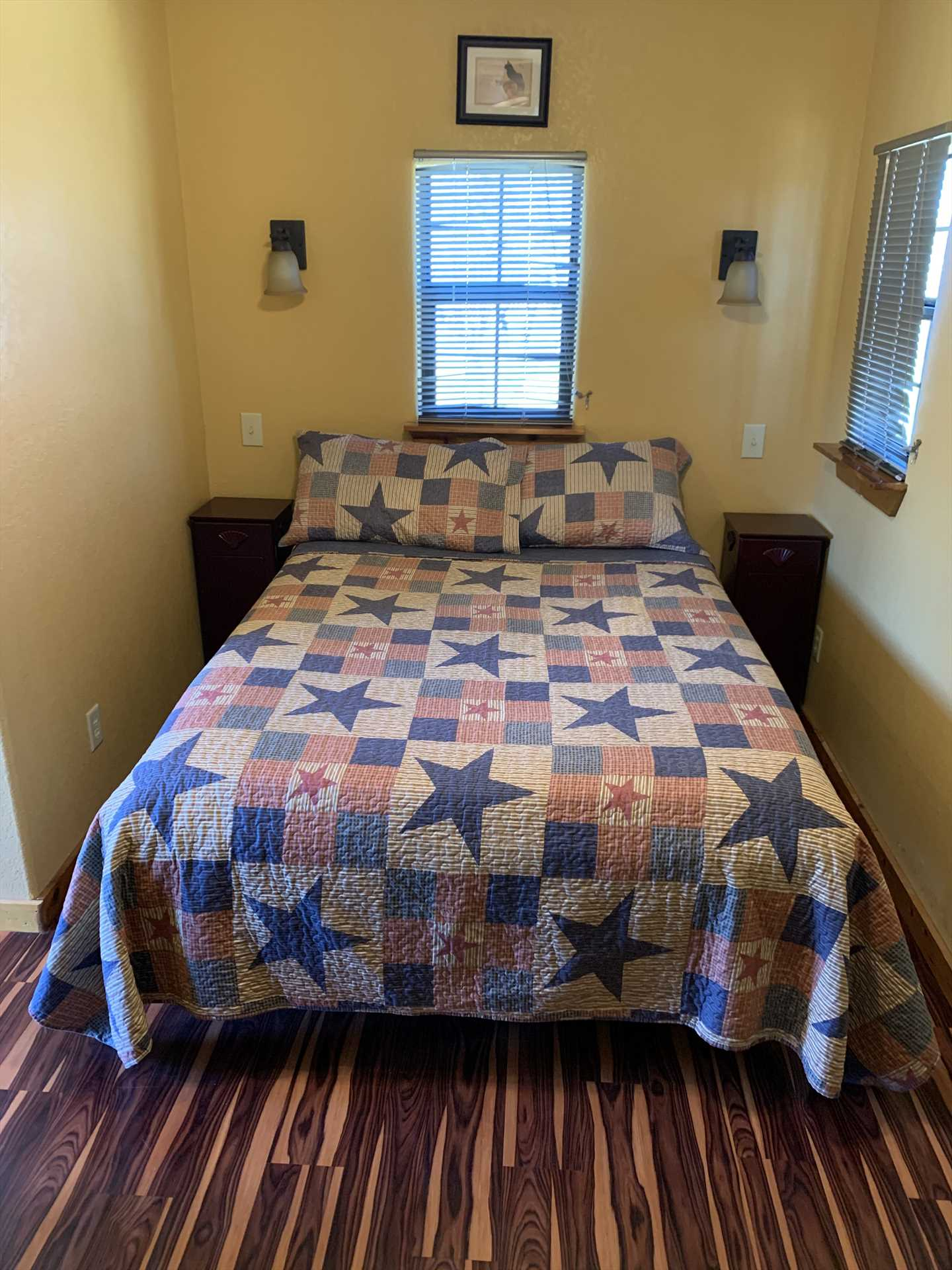 The queen bed provides sweet slumber for two, and there is a roll-away bed option available for a third guest.