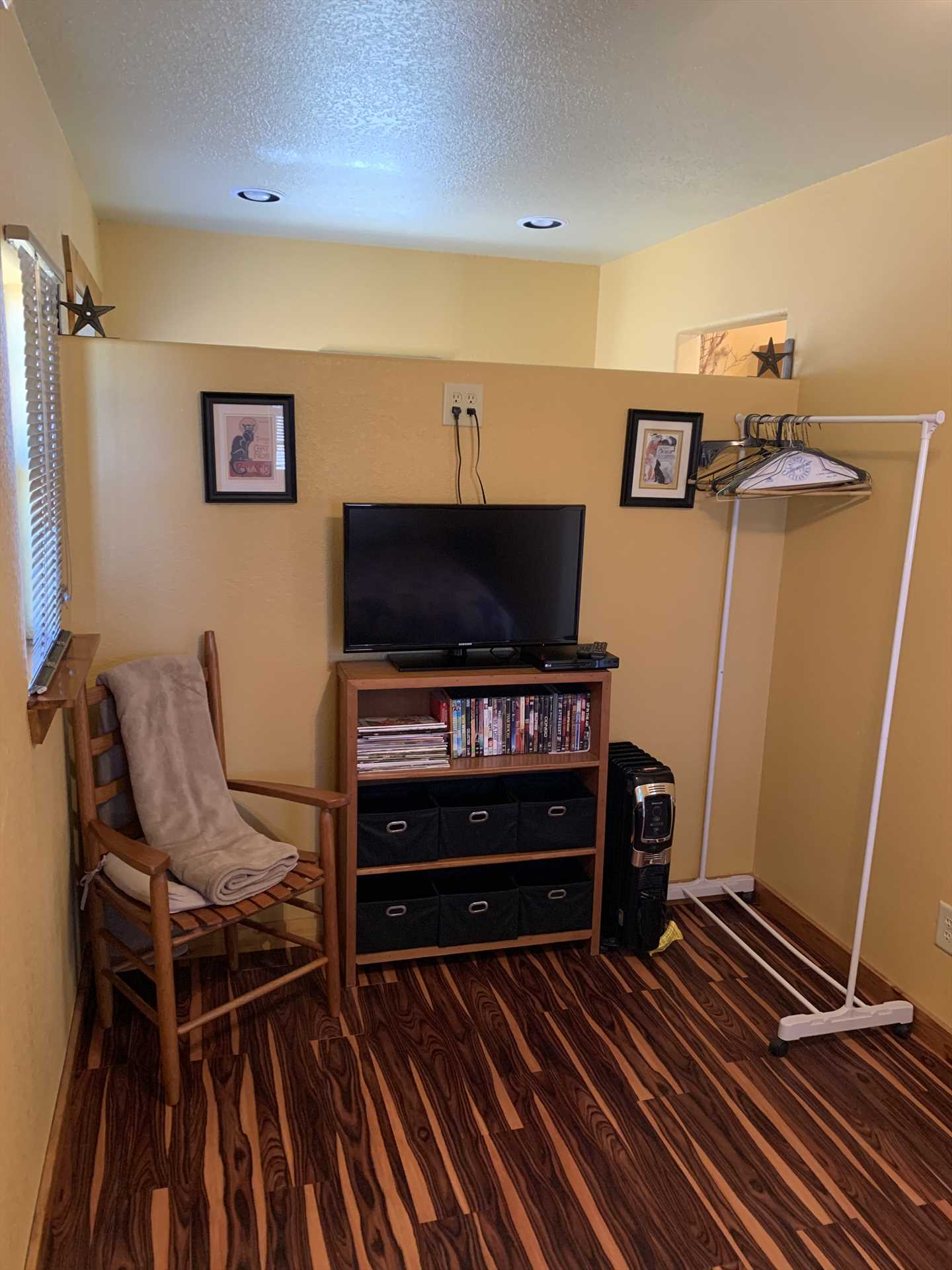 The TV here includes a DVD player, and there's also a CD player in the living area, it's a great spot to unwind, or to plan your day!