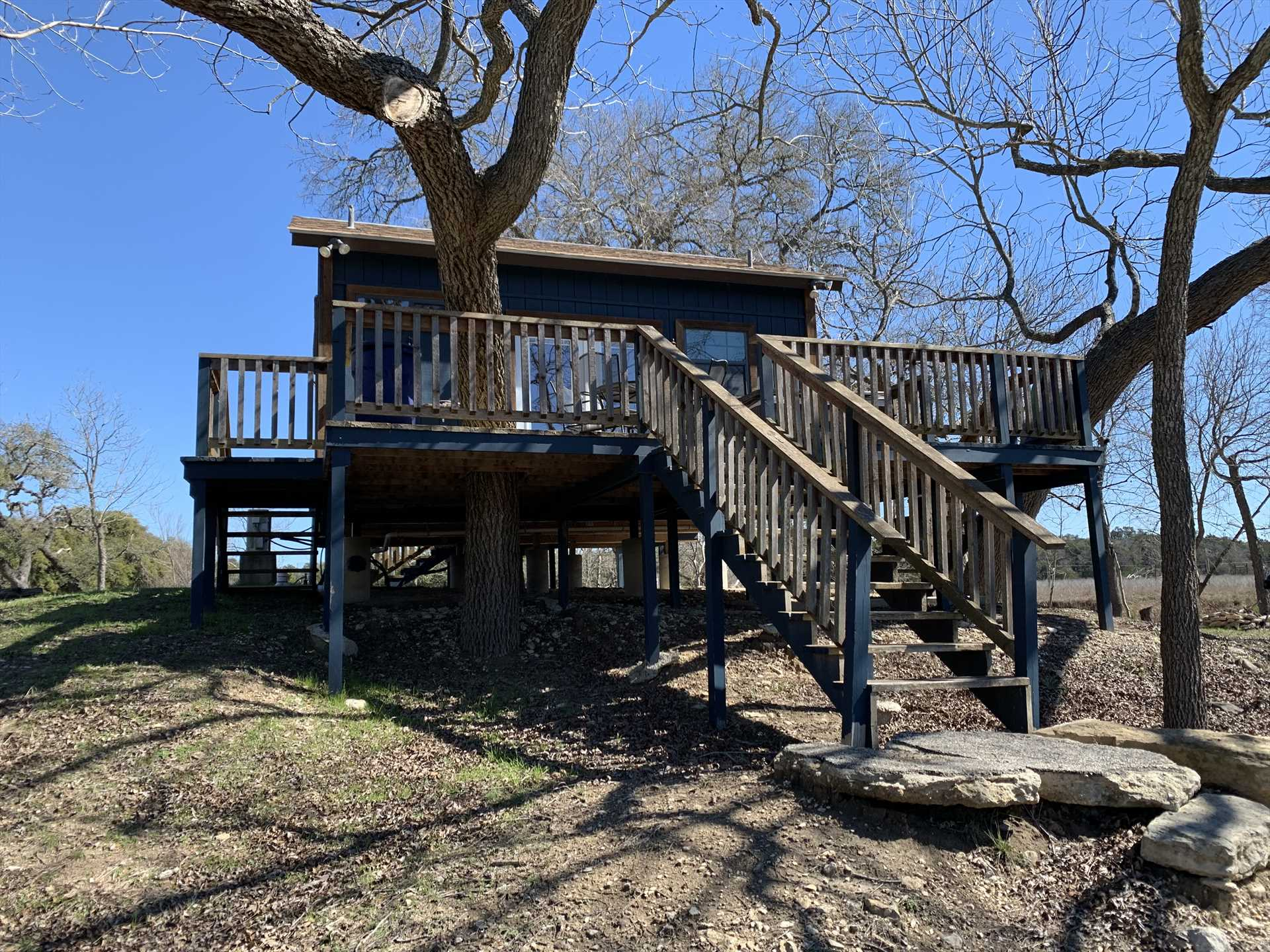 Revisit your childhood with a tree house retreat. Only THIS tree house has central air, a hot tub and a grill!