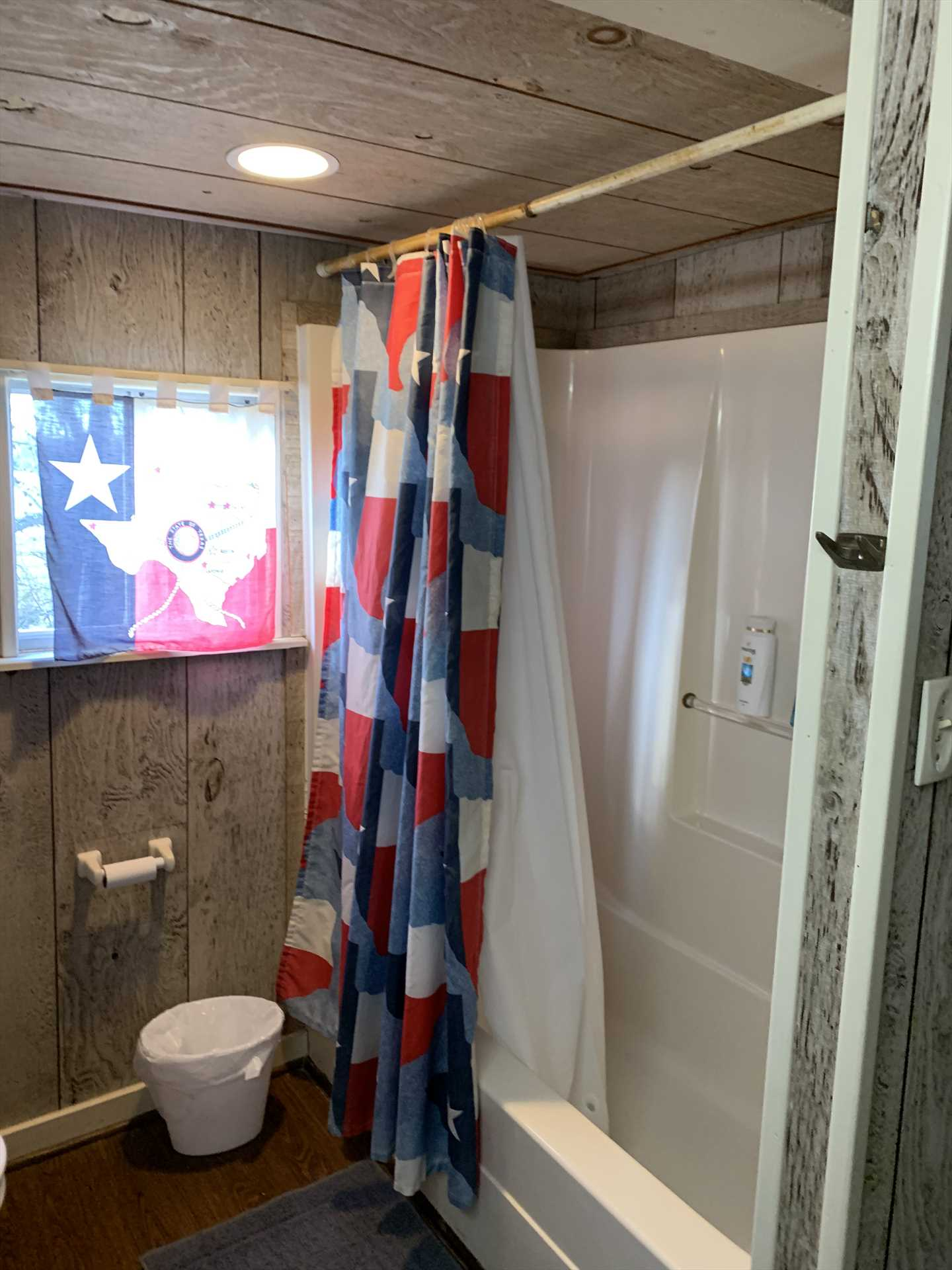 The Texas-themed bath includes a tub and shower combo, and all bed and bath linens for your stay are included, too!