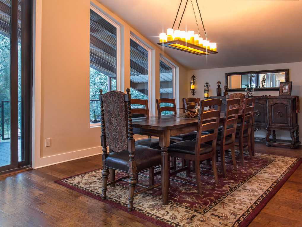 Natural light, beautiful wood furnishings, and a chandelier make every meal in the dining area a special event.