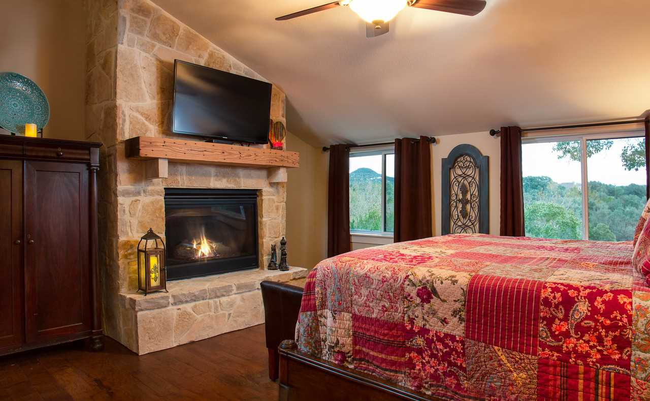 Satellite TV and a toasty fireplace share space with a roomy and comfortable king-sized bed in the master bedroom. All beds in the Barndominium come with clean and soft linens.
