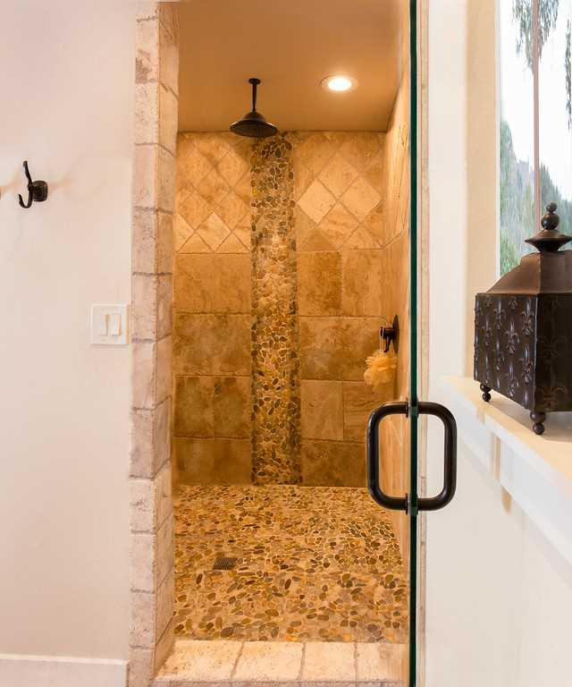 Feel like pampering yourself? Step into the enormous tiled shower in the master bath! Its unique rainfall shower head will make cleanup a relaxing experience.