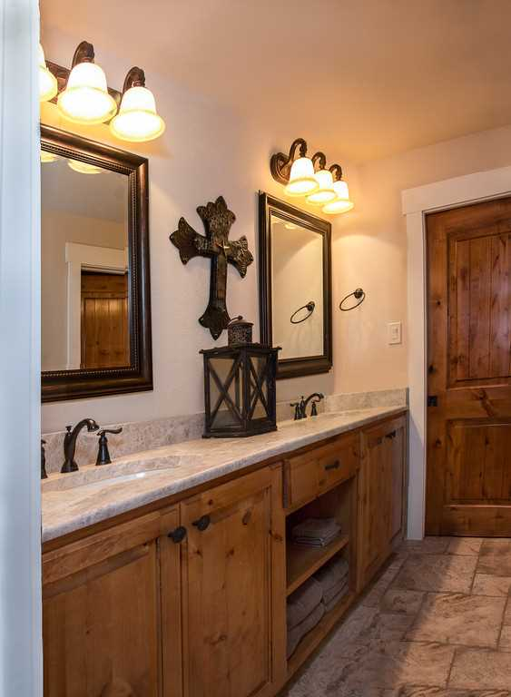 Royal treatment is yours even in the master bath, which is equipped with two spacious mirrored vanities! All the bathrooms are decked out with clean linens, too.