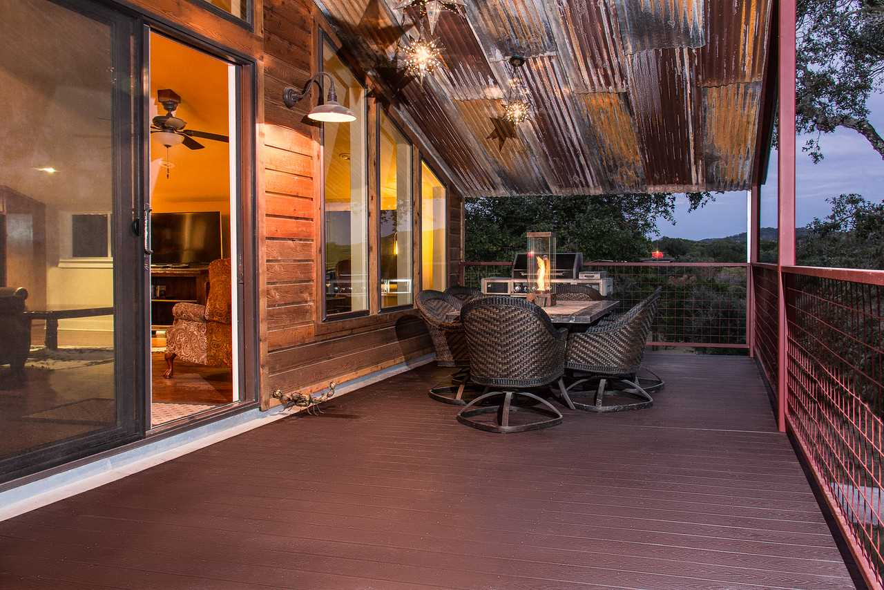 Tree house-like views of the gorgeous Hill Country are yours to enjoy from the elevated second-story deck!