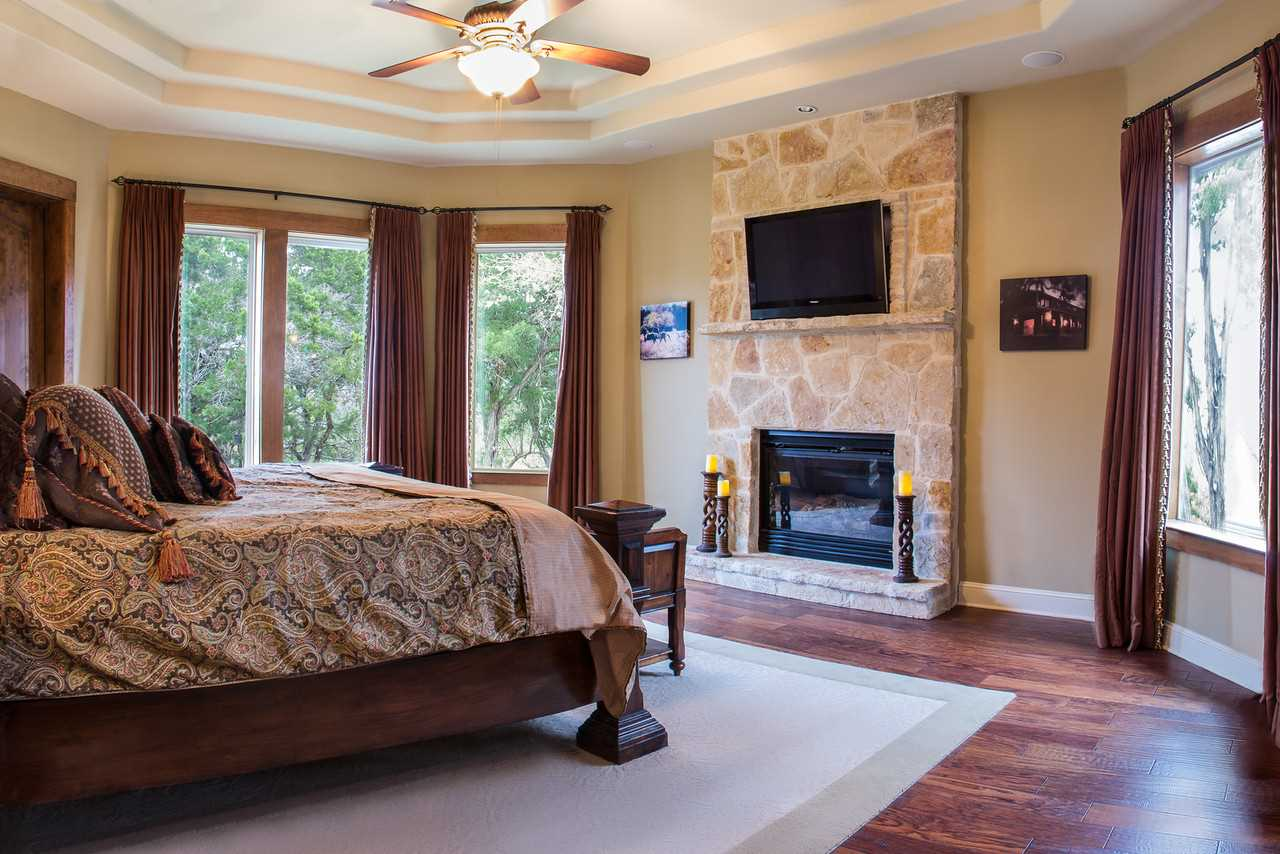 Rest like royalty in the grandeur of the master bedroom, furnished with a fireplace and king-sized bed! All sleep accommodations here come with clean and soft linens.