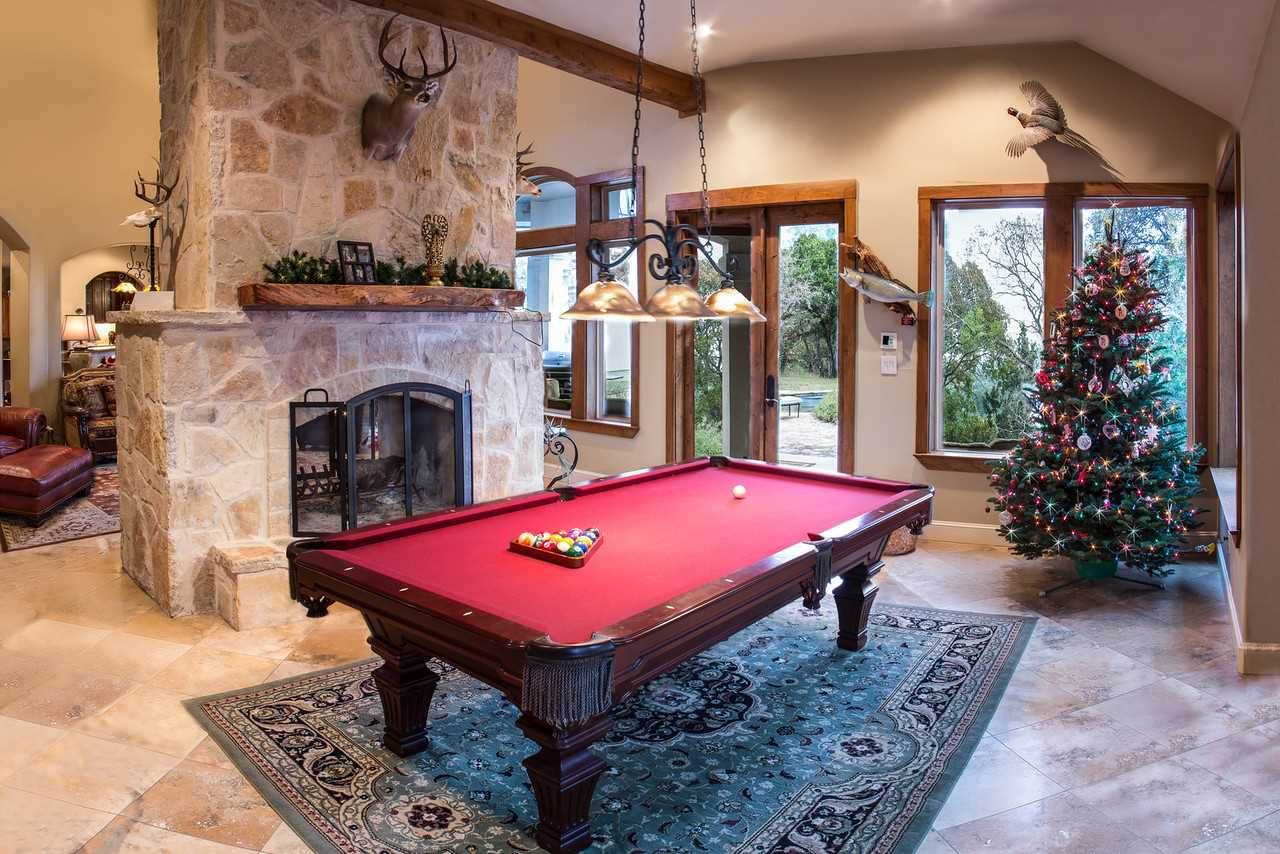 Put your resident pool shark to the test! The gorgeous stone fireplace you see here is shared with the living area on its other side.