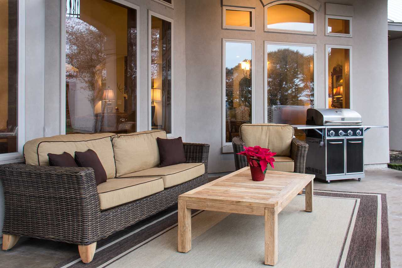 The huge patio serves as a second living area all its own, with super-comfy furniture and a gas grill for BBQ enthusiasts.