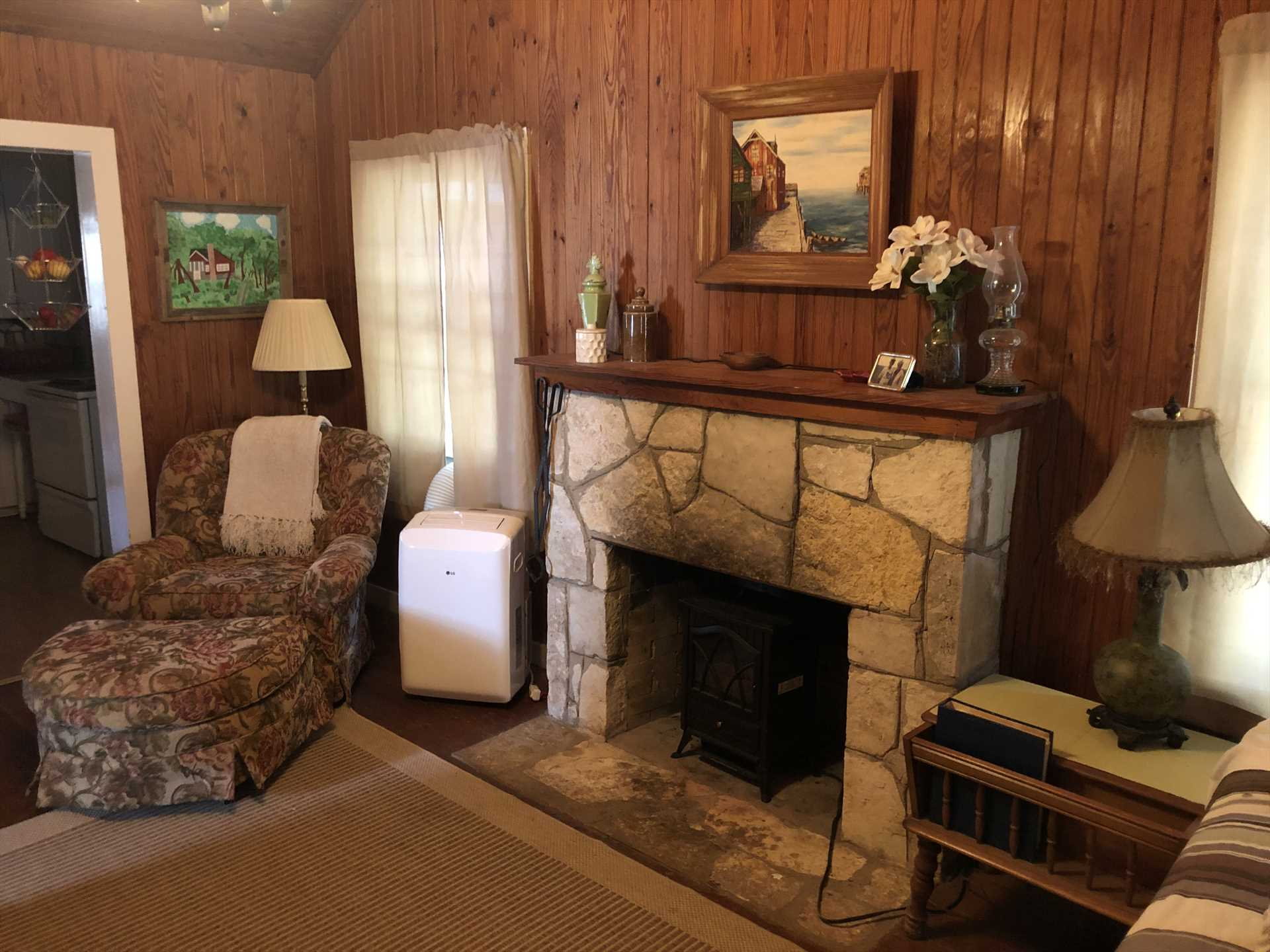The den sets the stage for an intimate gathering around the electric fireplace.