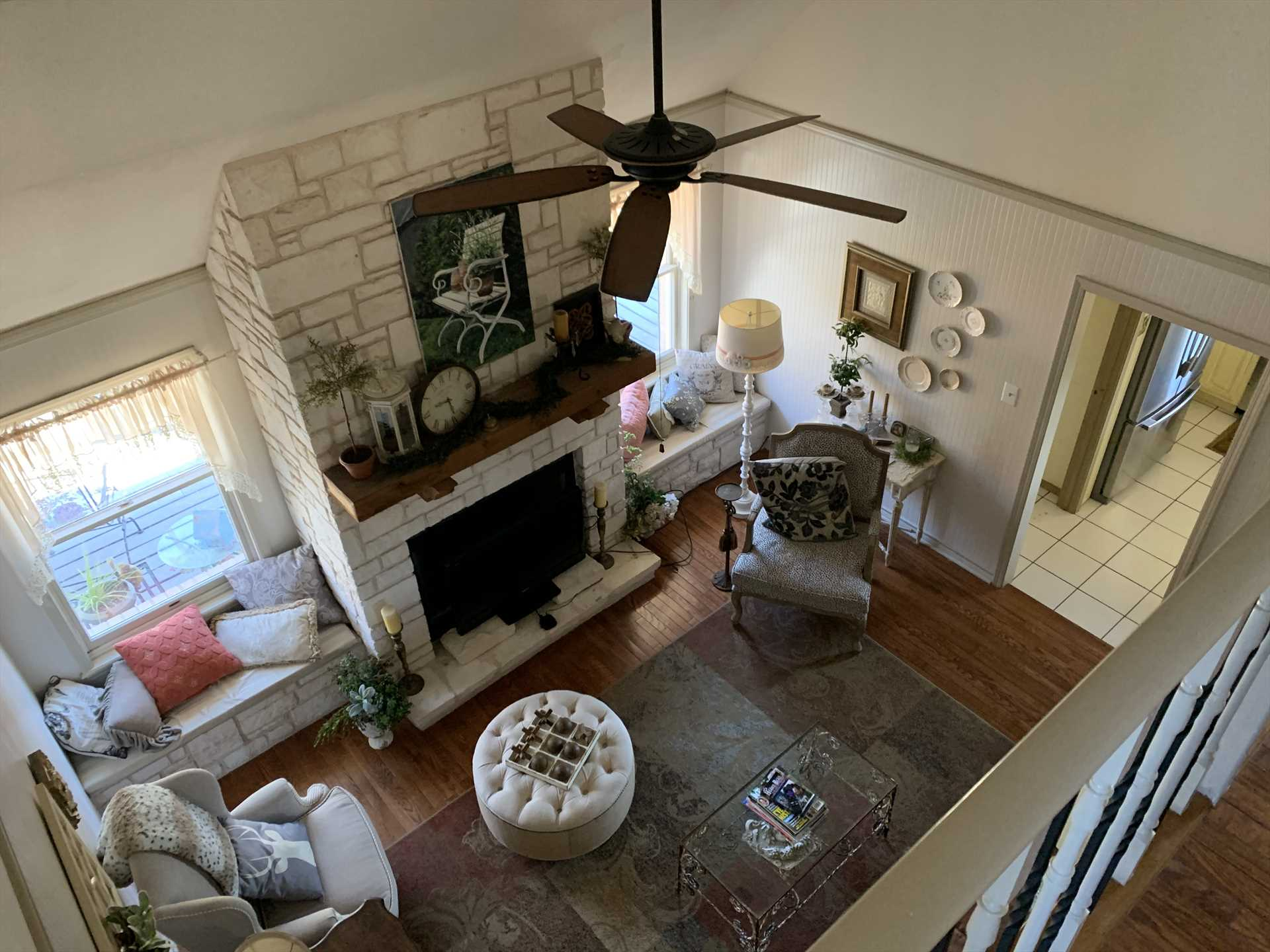 A fireplace adds warmth and style to the charming and fun living area!