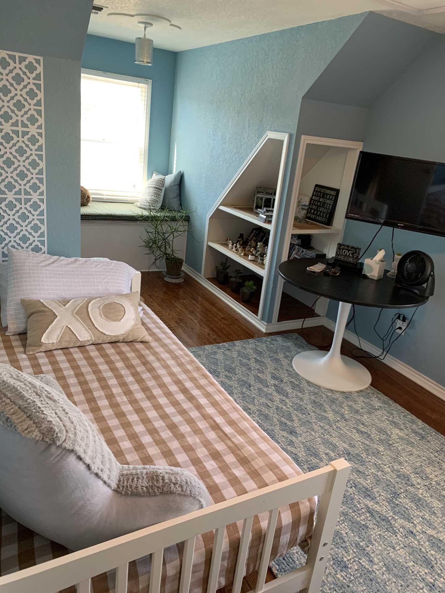 An entertainment center and reading nook are fun extras in the second bedroom, and fresh bed linens are supplied for all our guests.