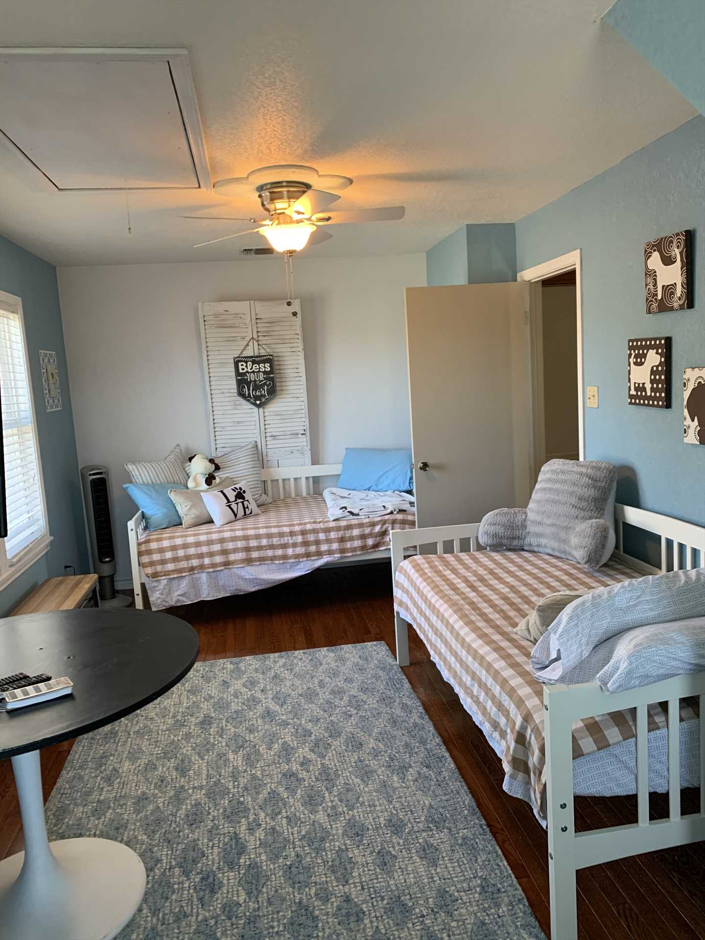 Two twin beds in the second bedroom help create a relaxing atmosphere for two guests. It makes a great kids' room!