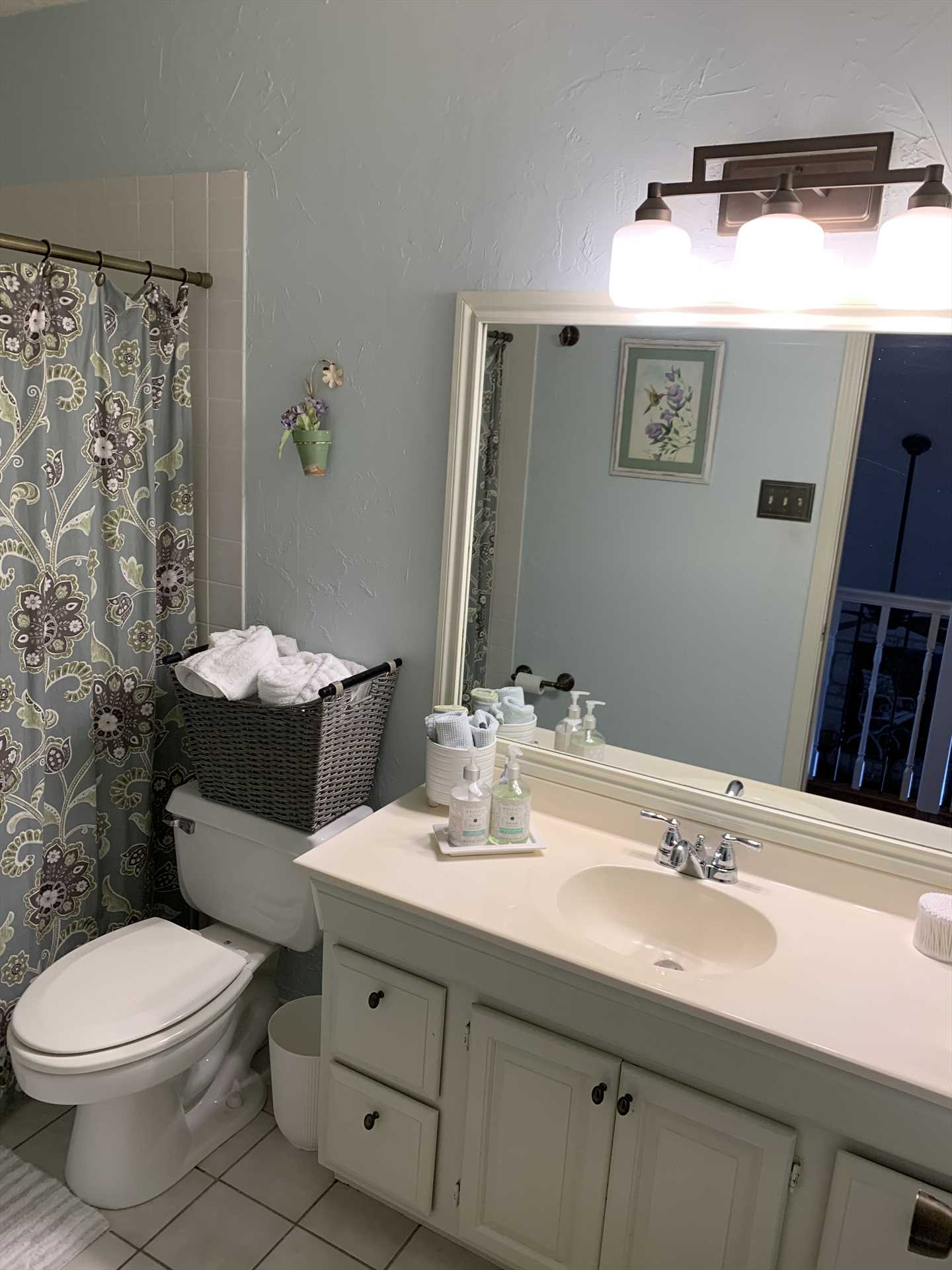 The full bath upstairs includes a tub and shower combo, along with plenty of fresh linens for your cleanup routine.