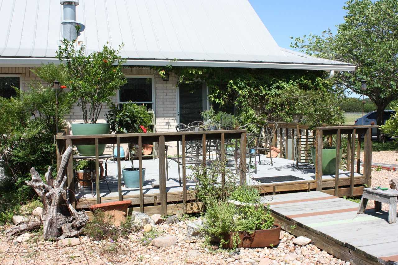 Beautiful plants on the deck help the guest house blend in perfectly with the gorgeous flora of the Hill Country!