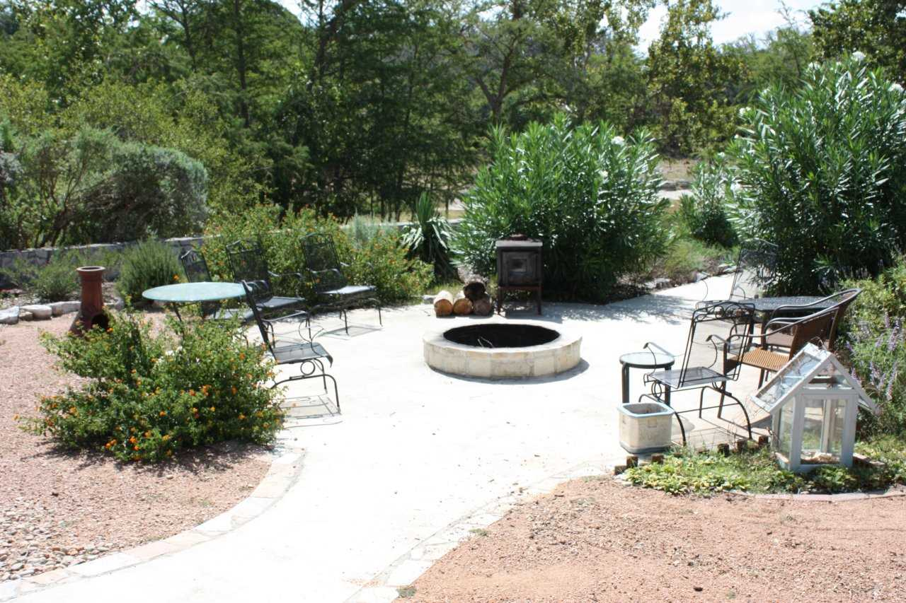 With a fire pit and charcoal grill on the back patio, you'll have no end of options for snacks and meals! Wildlife viewing and stargazing are awesome back here, too.