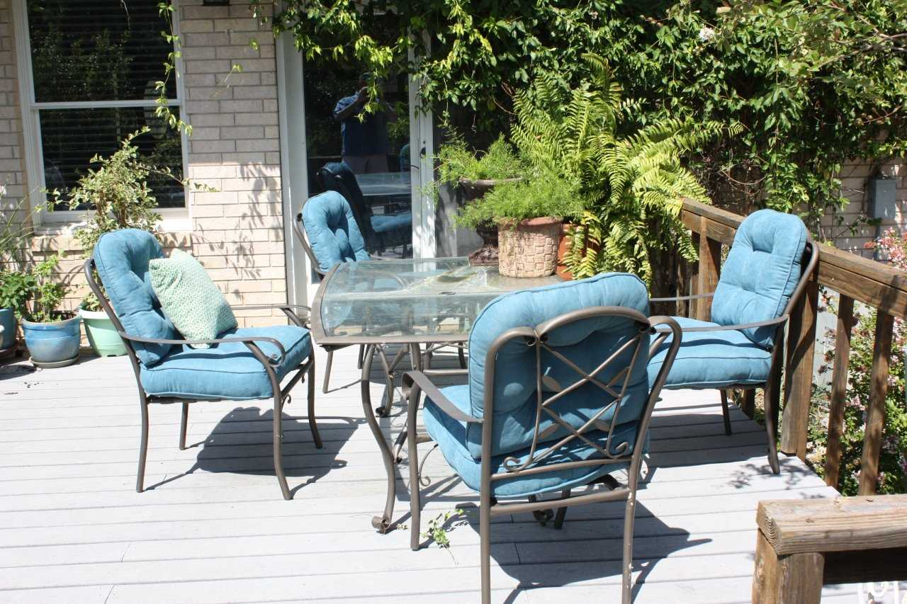 Cushioned outdoor furniture helps create a comfortable and enjoyable living area in the great outdoors!