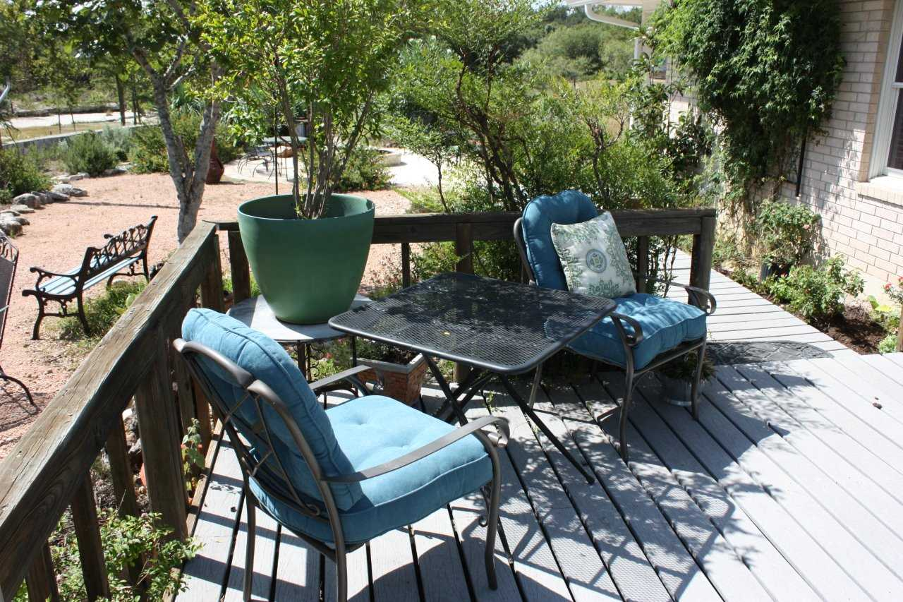 There's plenty of comfy outdoor seating, fresh air, and amazing Hill Country views available on the roomy deck out back!