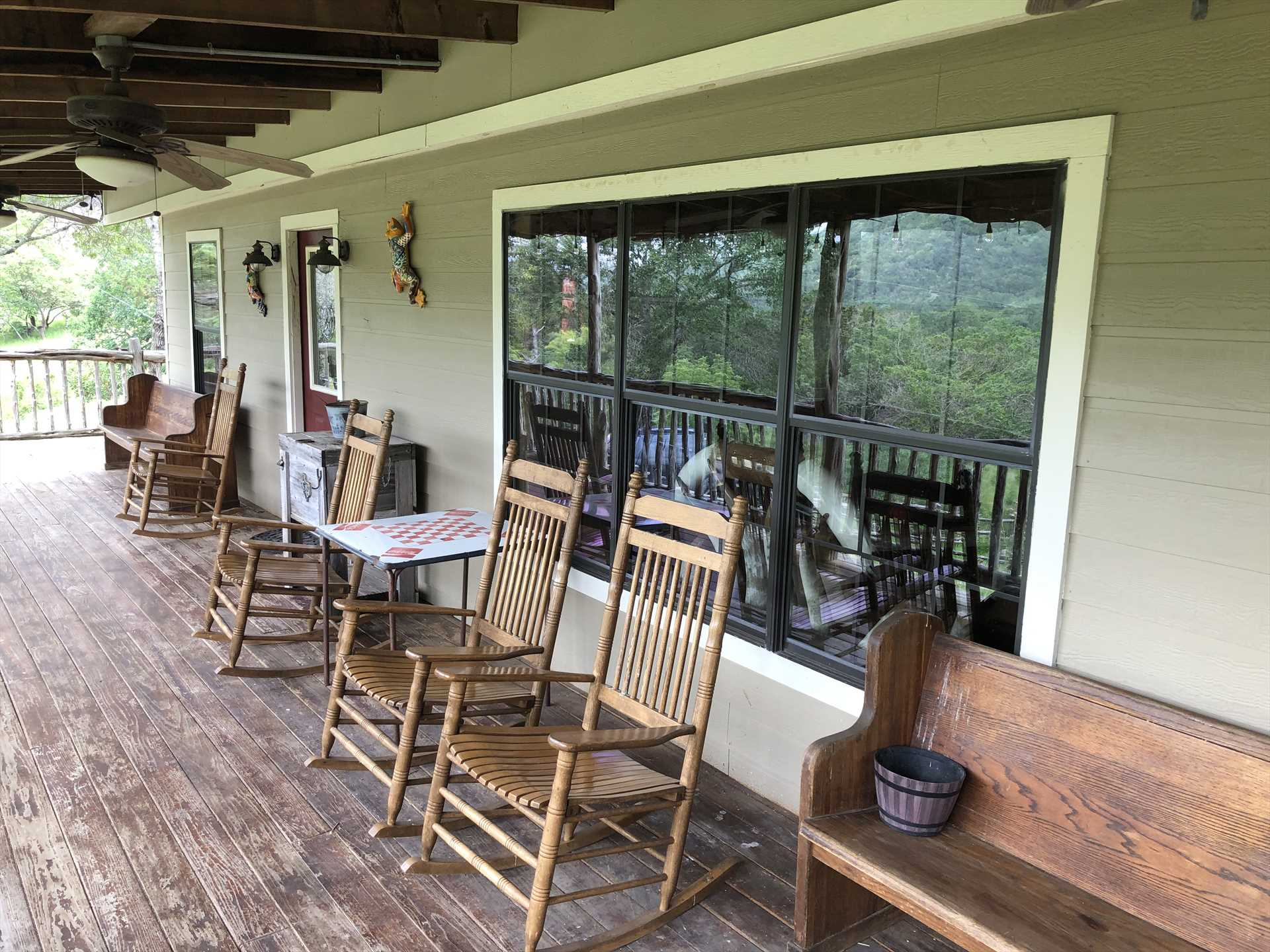 A glass of wine, a rocking chair, and sweet mountain breezes all await you on the shaded country porch!