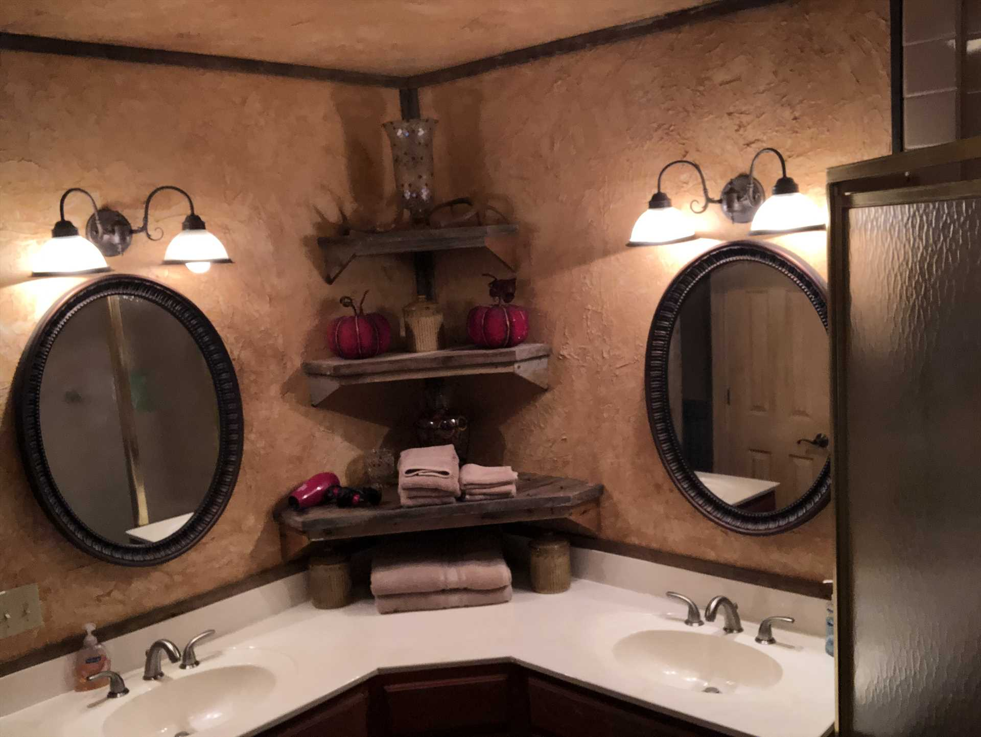Twin vanities and a roomy shower stall round out a master bedroom fit for royalty!