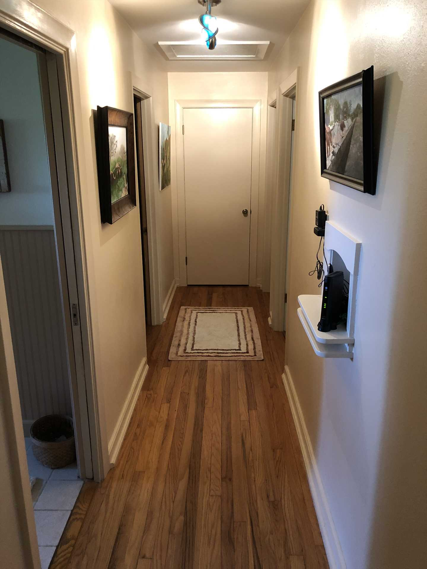 Some may just see a hallway, but we see rich woodwork, framed pictures, and an area rug-special extras you won't find just anywhere!