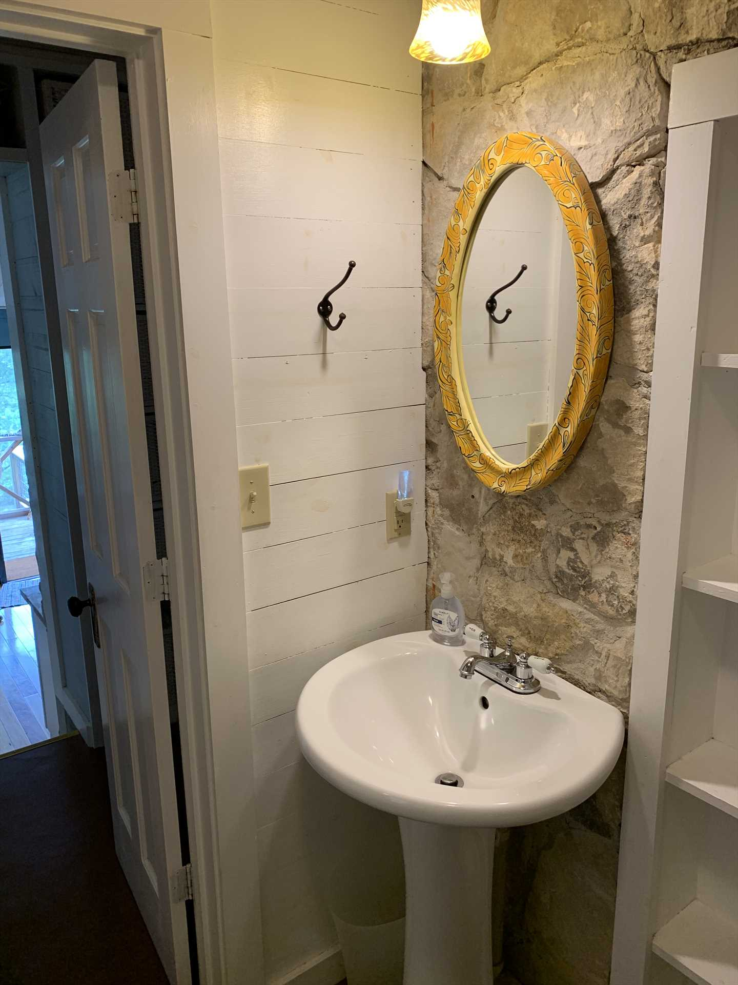 The stone wall and pedestal-style vanity are just two examples of the unique touches throughout the retreat.