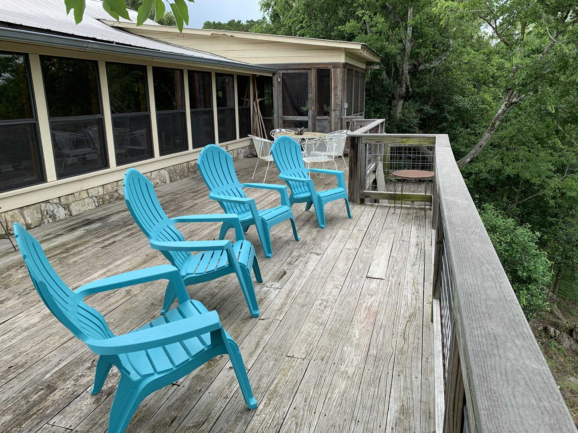 The sunny back deck is a great spot to stargaze and enjoy panoramic Hill Country views.