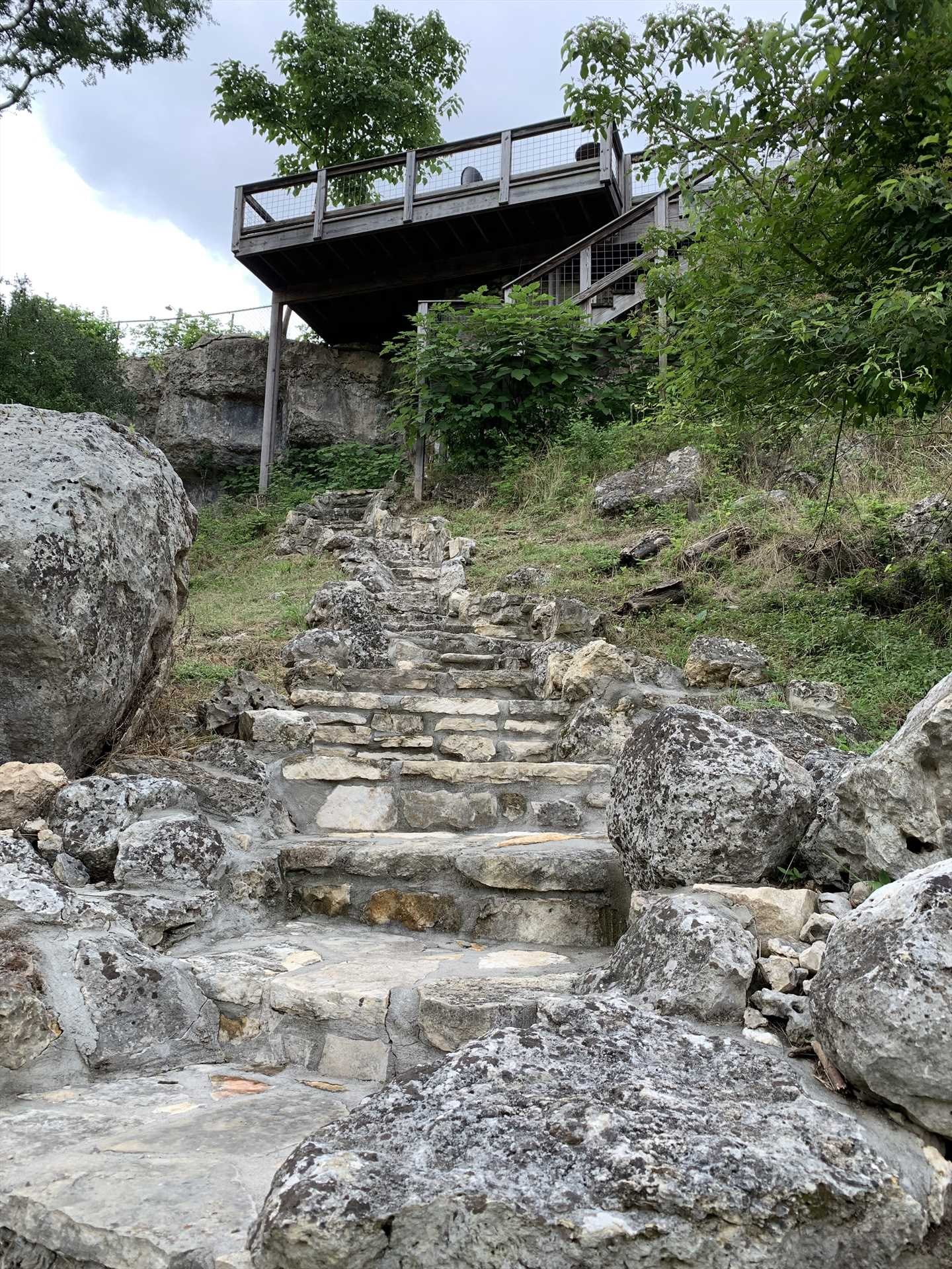 The retreat's perched on a ridge right above the river, which is easily accessed by the stone staircase out back.