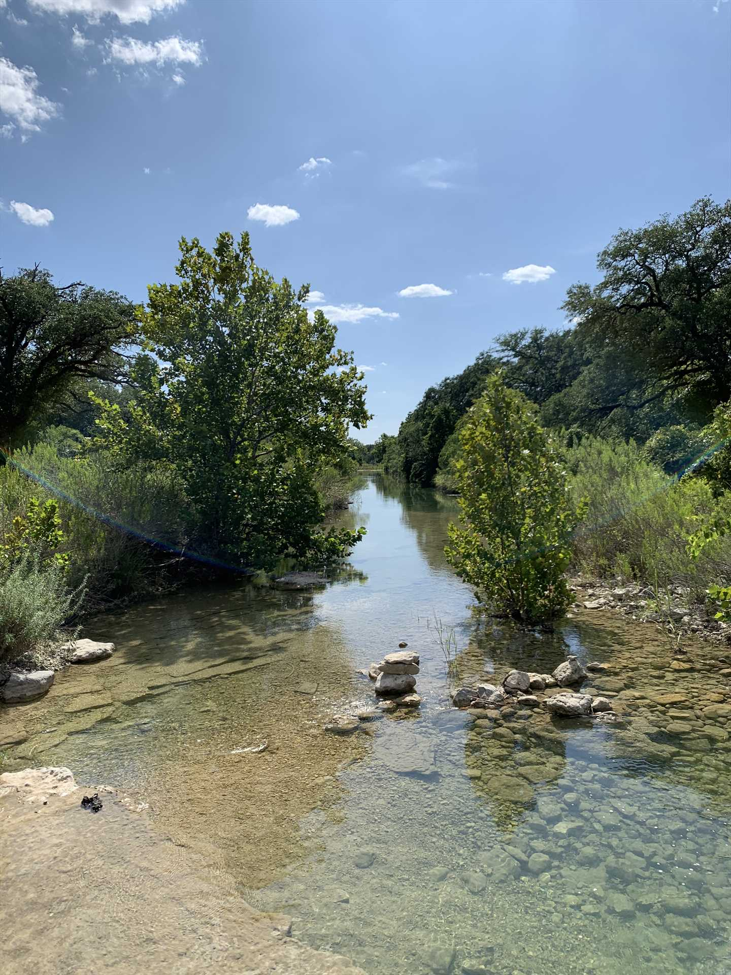 Feel free to hike the 16 acres of property here, including the peaceful banks of a bubbling creek.