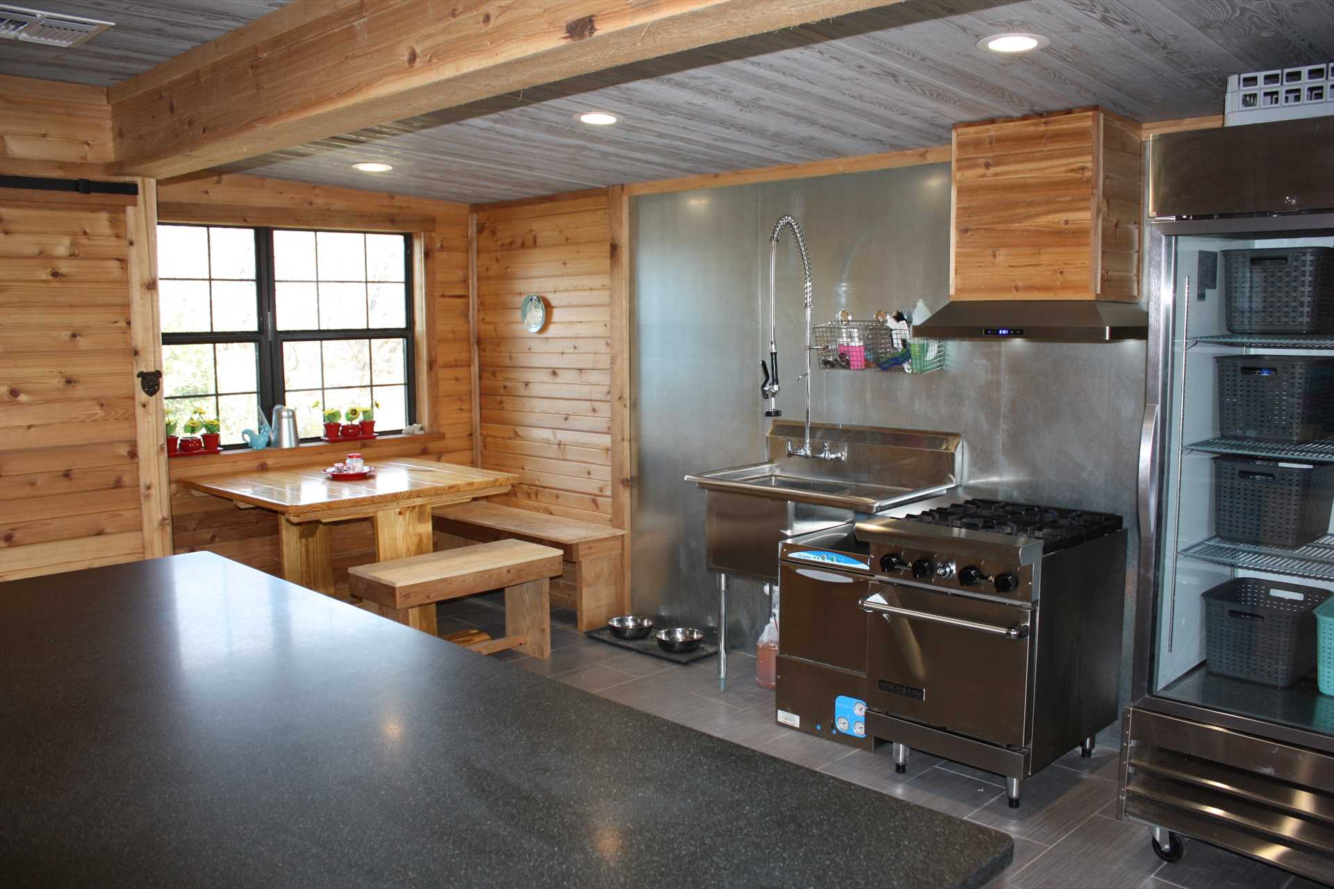 The kitchen is decked out with modern appliances in plenty of space!