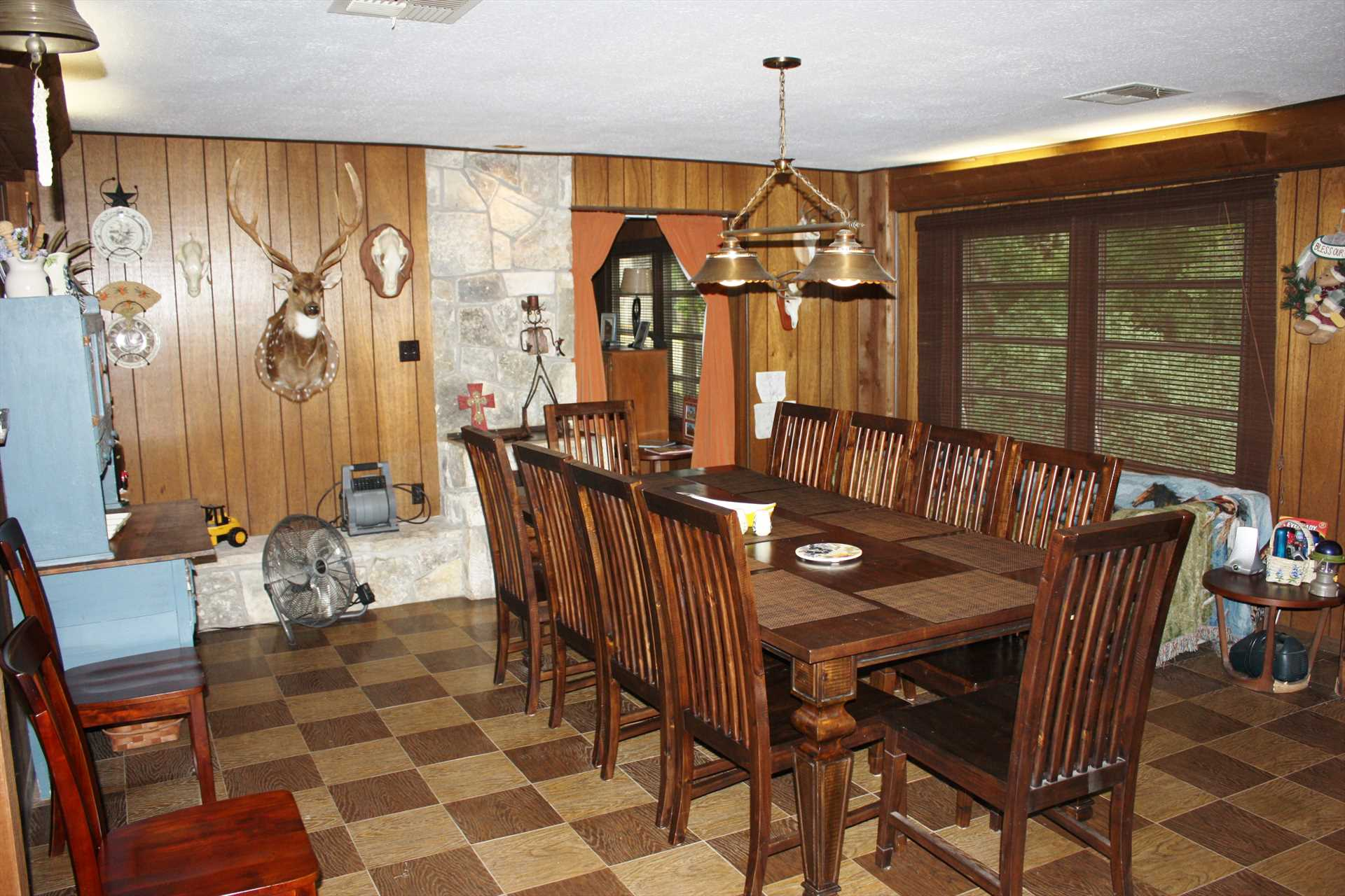 The handsomely-appointed dining room offers plenty of space for a family feast! The table is also great for gaming.
