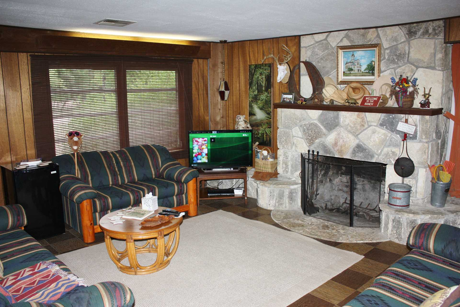 Satellite TV, Wifi, and a big fireplace make the living area of the main cabin a warm and wonderful centerpiece for your Hill Country holiday!