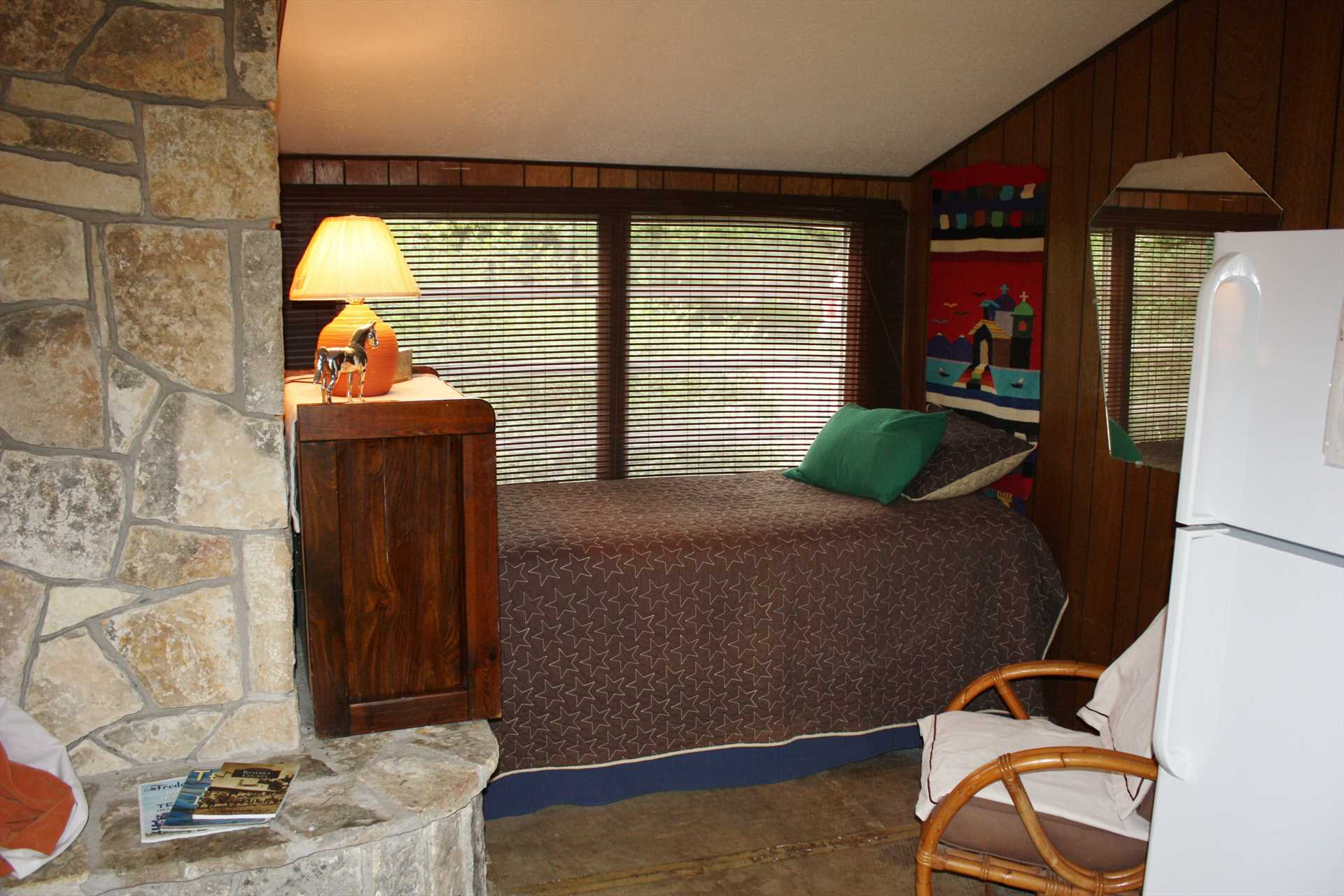The second bedroom in the main house has two twin beds and sleeps four. How, you may ask? Two more convenient trundle beds roll out from under!