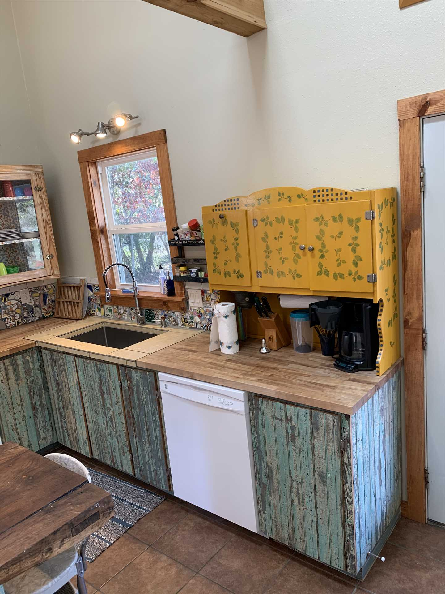 Rustic, vintage cabinetry highlights the full and modern kitchen!