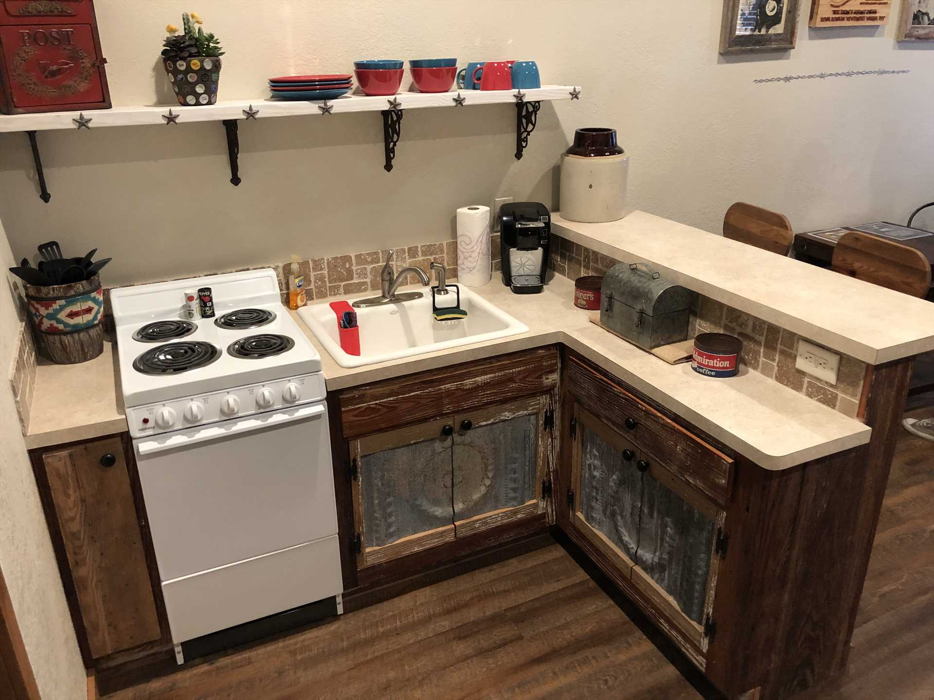 Wonderful ranch-style decor with modern amenities! We're pretty sure the ranch hands of olden days didn't have a K-Cup coffee maker.