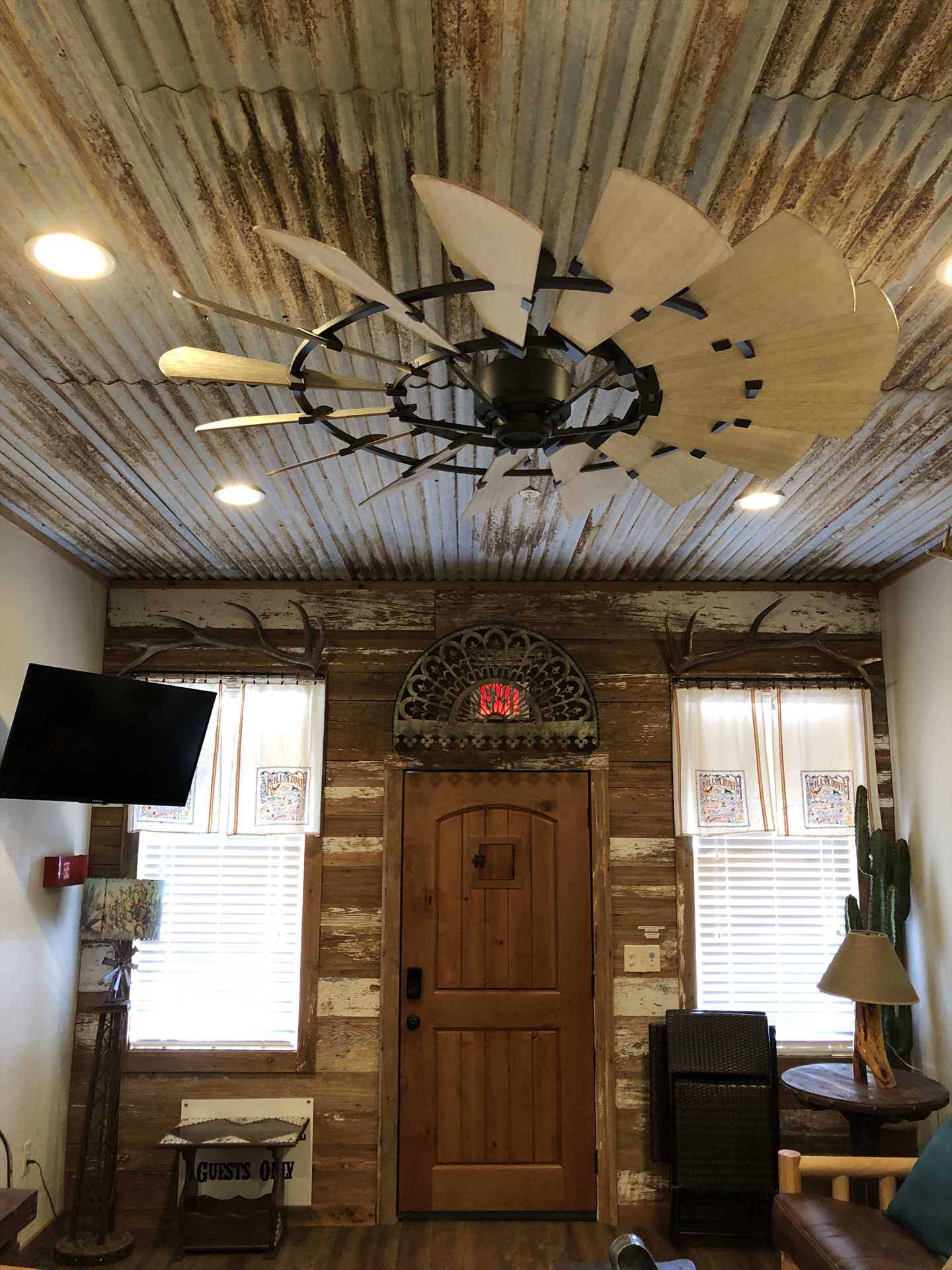 A ceiling fan reminiscent of a Texas prairie windmill keeps air moving in the cabin, it's a perfect companion for the central air and heat here!