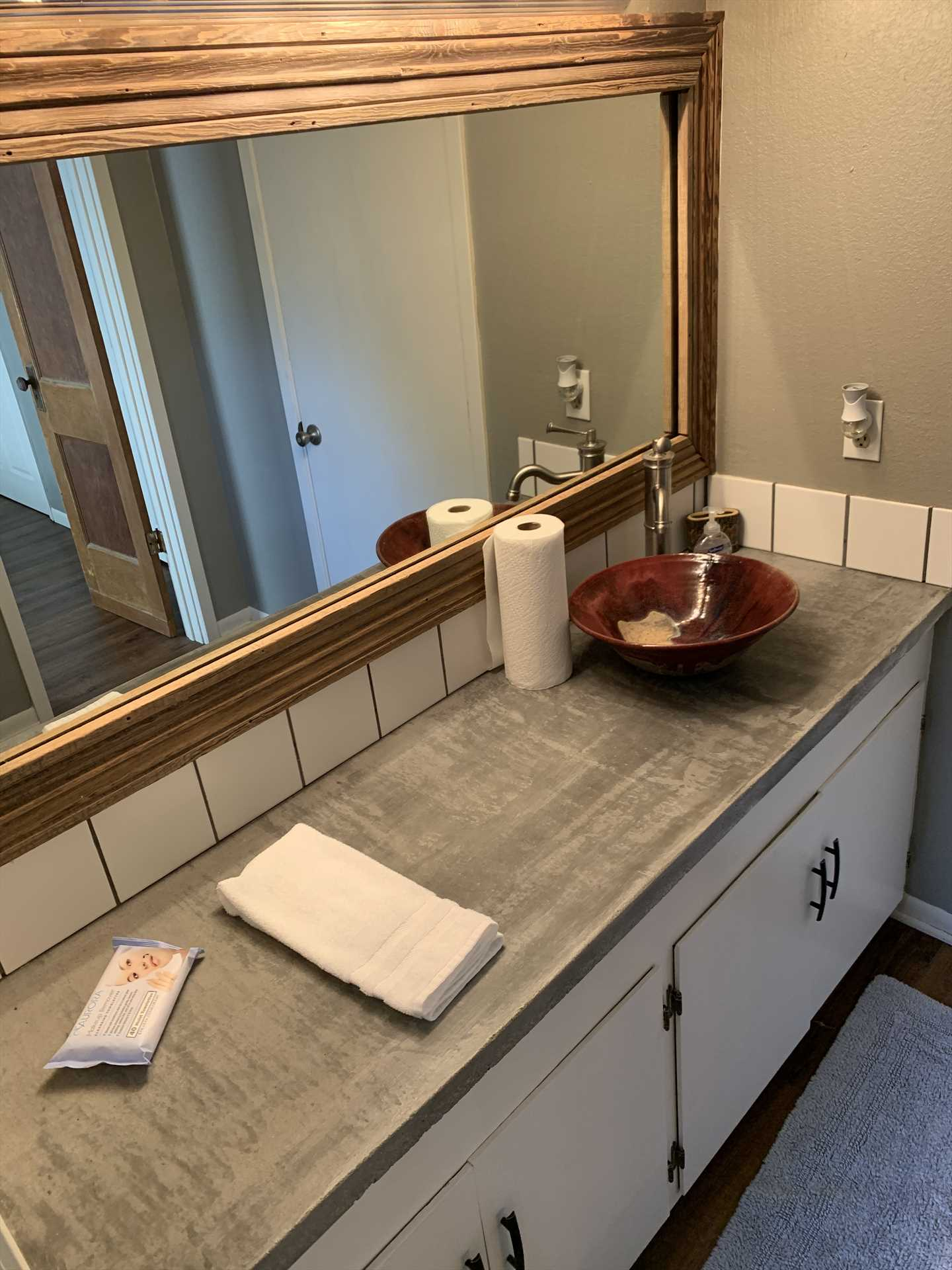 The master bath features a tub and shower combo, a big bowl vanity, and plenty of counter space for your toiletries.