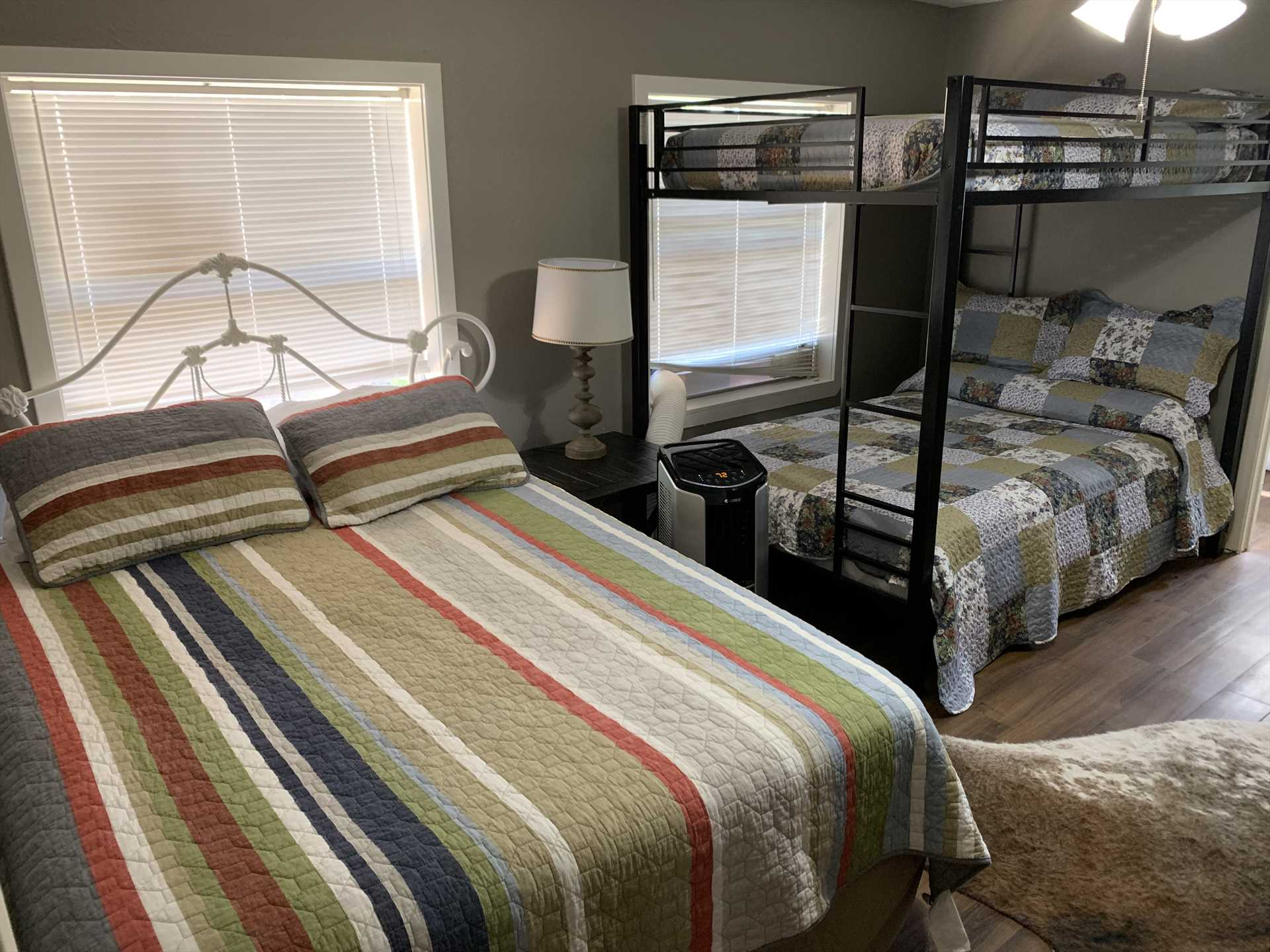 The second bedroom comfortably sleeps up to five with a queen bed, and a bunk-style setup with a double under and a twin up top.