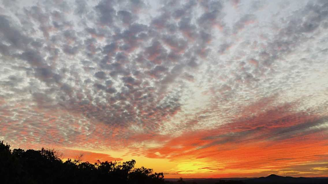 The restful quiet of the Hill Country is silhouetted in beautiful contrast against fiery sunsets.