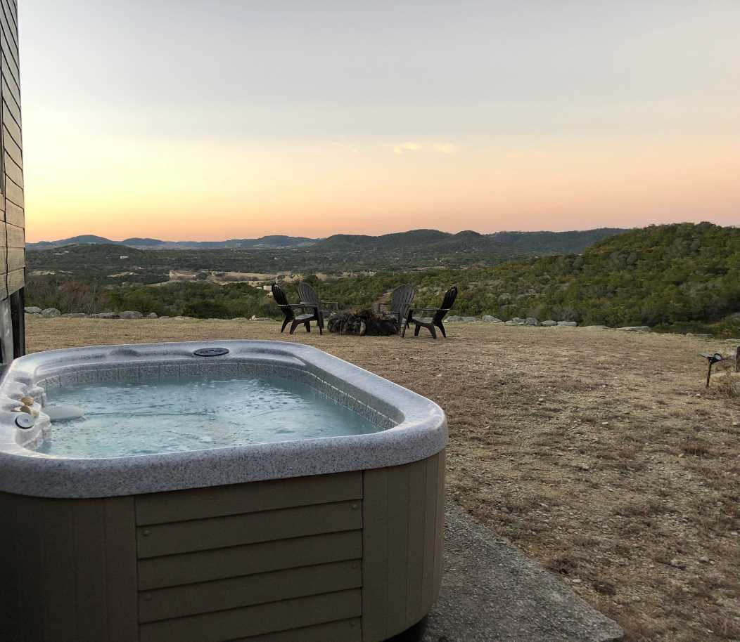 Slip into the hot tub with a glass of wine, and take in the multicolored dazzle of a Hill Country sunset.
