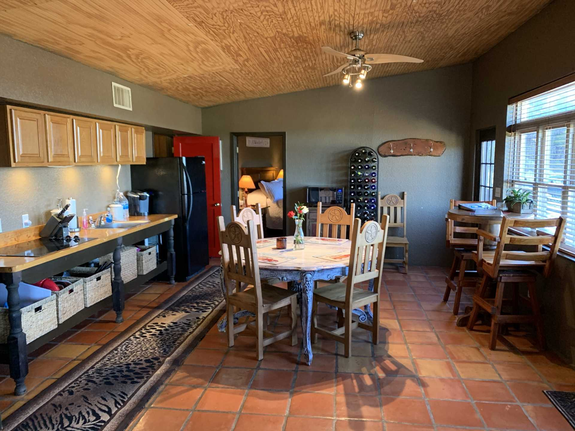 The kitchen, dining, and living areas are wide open, so no one will feel