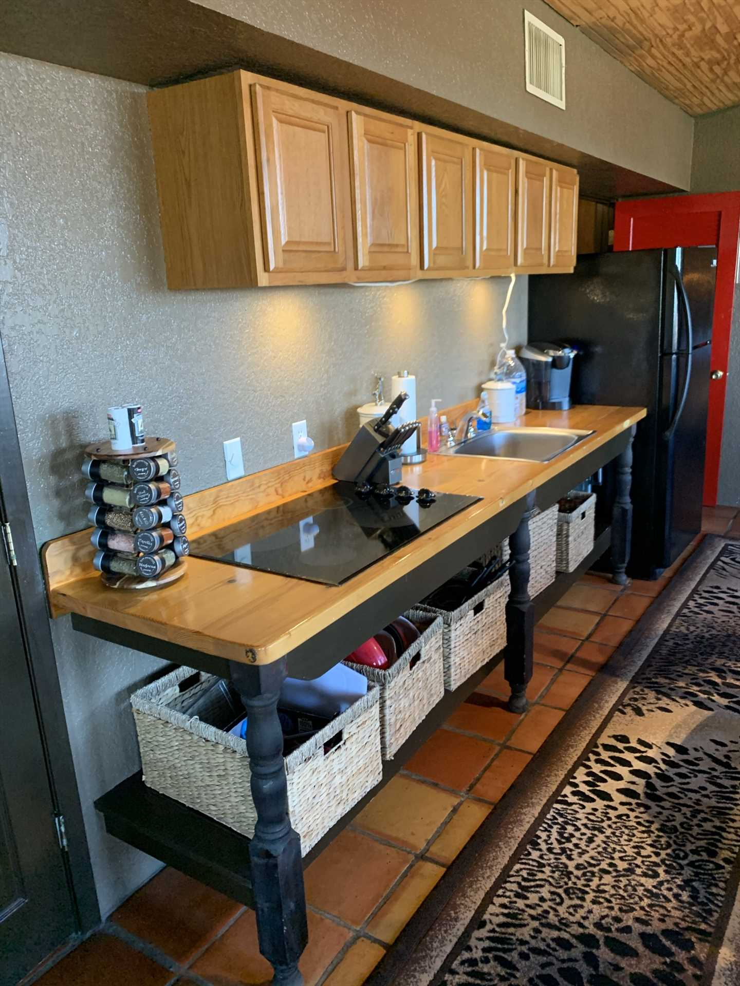 All the cookware, utensils, and serving ware are in the full kitchen, all you'll need for a hearty family meal!